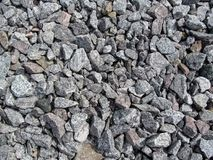 Der Hintergrund der grauen Kieskopfsteine Stockfotografie