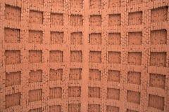 Der Hintergrund ist eine alte Backsteinmauer, die mit brauner Farbe, herein gemalt wird Stockfotos