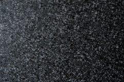 Der Hintergrund ist schwarz und silbern Lizenzfreies Stockbild