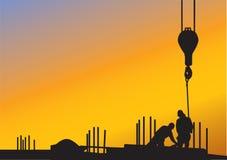 Der Hintergrund mit Bauarbeitern Stockfotos