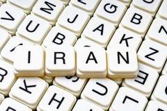 Der Iran-Textwortkreuzworträtsel Alphabetbuchstabe blockiert Spielbeschaffenheitshintergrund Stockbilder
