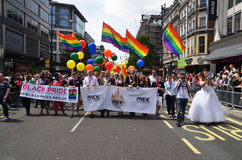 Der jährliche Stolzmarsch durch London, das Homosexuelles feiern, Lesbia Lizenzfreies Stockbild