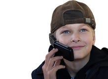 Der Jugendliche ist sich über das Telefon einig Lizenzfreie Stockbilder