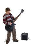 Der Junge, der eine elektrische Gitarre spielt, trennte Stockbild