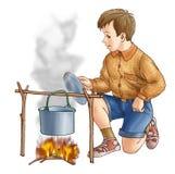 Der Junge an einem Feuer Lizenzfreie Stockbilder