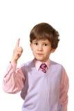 Der Junge in einem rosafarbenen Hemd Lizenzfreies Stockfoto