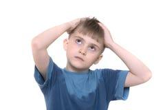 Der Junge gekuppelt am Kopf Stockbilder