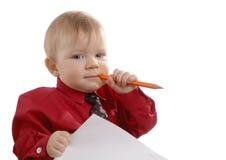 Der junge Geschäftsmann mit einem Bleistift in einer Hand Stockfoto