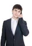 Der junge Geschäftsmann mit Handy Stockfoto