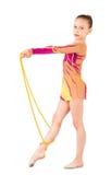 Der junge Gymnast steht mit einem Seil Stockfoto