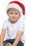 Der Junge im Hut von Santa Claus Stockbilder