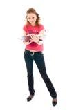 Der junge Kursteilnehmer mit Bücher getrennt auf einem Weiß Lizenzfreies Stockbild