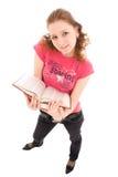 Der junge Kursteilnehmer mit Bücher getrennt auf einem Weiß Lizenzfreies Stockfoto