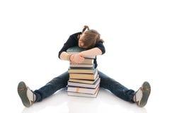 Der junge Kursteilnehmer mit den Büchern Lizenzfreie Stockfotos
