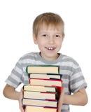 Der Junge liest das Buch Stockbilder