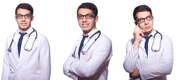Der junge männliche Doktor lokalisiert auf Weiß Lizenzfreie Stockfotos