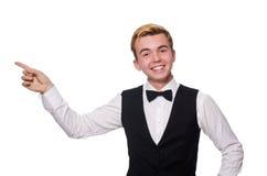 Der junge Mann in der schwarzen klassischen Weste an lokalisiert Stockfoto