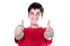 Der junge Mann, der zwei Daumen zeigt, up Zeichen Stockbild