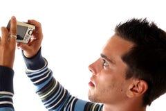 Der junge Mann mit Kamera Stockfotografie