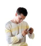 Der junge Mann mit Telefon Lizenzfreies Stockbild