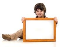 Der Junge mit einem Feld Stockfoto