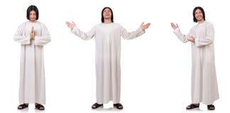 Der junge Priester mit der Bibel lokalisiert auf Weiß lizenzfreies stockbild