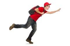 Der junge Reisende mit dem Rucksack an lokalisiert Stockbild