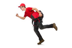 Der junge Reisende mit dem Rucksack an lokalisiert Stockbilder