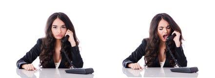 Der junge Telefonbetreiber auf Weiß Stockfoto