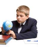 Der Junge und die Bücher Lizenzfreie Stockbilder