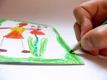 Der Junge zeichnet einen Wunsch stockbilder