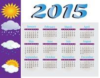 Der Kalender mit einem Bild der Jahreszeiten auf dem Blau Lizenzfreies Stockfoto