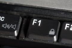 Der Knopf des Laptops F1 Lizenzfreies Stockbild