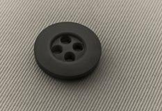 Der Knopf ist dunkelgrau Stockfotografie