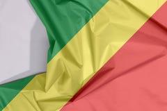 Der Kongo-Gewebeflaggenkrepp und -falte mit Leerraum stockfoto