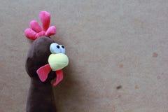 Der Kopf der Spielzeughenne Stockfotos