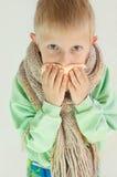 Der kranke Junge Stockfoto
