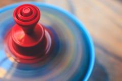 Der Kreisel-Spielzeug des Kindes Stockbilder
