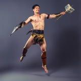 Der Krieger im Bild der Antike Streik des Schinkens Stockfotografie
