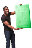 Der lächelnde afrikanische Mann als schwarzer Geschäftsmann mit Stockfoto