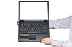 Der Laptop in den ausgedehnten Händen Lizenzfreie Stockfotografie