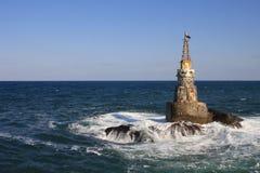 Der Leuchtturm im Meer. Stockfotos