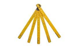 Der lokalisierte Faltenmachthaber, gelbe Tischler ` s Regel mit Zentimeter nummeriert Lizenzfreie Stockfotos