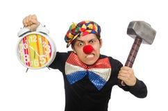 Der lustige Clown mit Hammer und Uhr auf Weiß Stockbilder