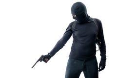 Der Mörder feuert eine Pistole mit einem Schalldämpfer in einer Lügenperson ab Stockfotos