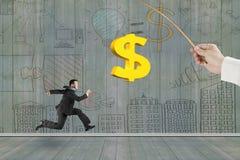 Der Mann, der goldenes Dollarzeichen-Fischködergeschäft laufen lässt, kritzelt wal Lizenzfreie Stockbilder