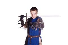 Der Mann in der Rüstung. Ritter. Stockfotografie