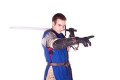 Der Mann in der Rüstung. Ritter. Lizenzfreie Stockfotos