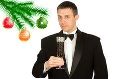 Der Mann des glücklichen neuen Jahres in einem klassischen Smoking Stockbilder