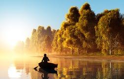Der Mann in einem Boot lizenzfreies stockbild